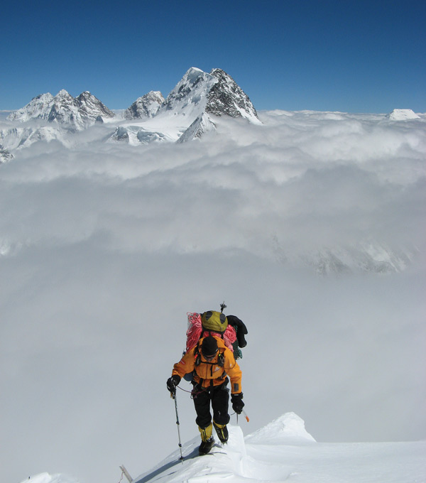Chris Warner Climbing Above the Clouds