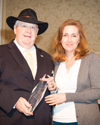 Norm Cates Receiving Club Industry's Lifetime Achievement Award From Pamela Kufahl