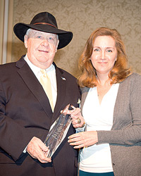 Pamela Kufahl Presents Norm Cates With Club Industry's Lifetime Achievement Award